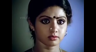 Sridevi gorgeous actressremoving her half-top and showing her bra.